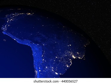 Brazil from space at night with stars in the background. Elements of this image furnished by NASA.
