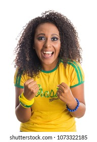 Brazil supporter. Brazilian woman fan celebrating on soccer / footbal match isolated on white background. Brazil colors.