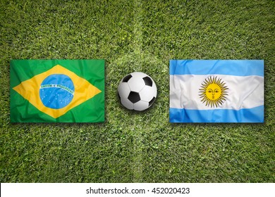 Brazil vs. Argentina flags on green soccer field