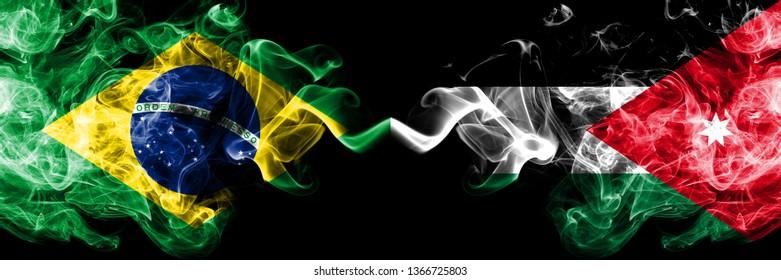 Brazil vs Jordan, Jordanian smoke flags placed side by side. Thick colored silky smoke flags of Brazilian and Jordan, Jordanian