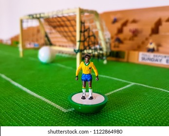 Brazil World Cup Subbuteo football figures lined up on a grass football field