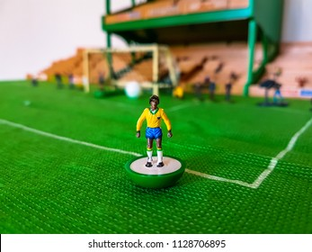 Brazil World Cup Subbuteo football figures lined up on a grass football field