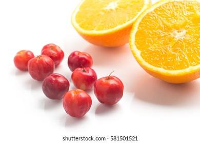 Brazilian Acerola Cherry and Orange Fruit isolated on white background