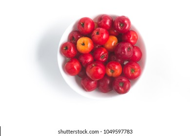 Brazilian Acerola Fruit in a bowl isolated on white background