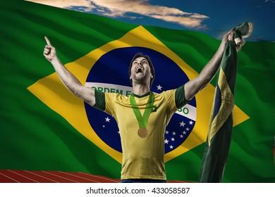 Brazilian Athlete Winning a golden medal in front of a brazilian flag.