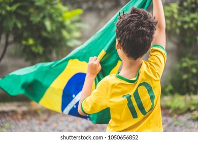 Brazilian Boy Holding the Flag of Brazil.