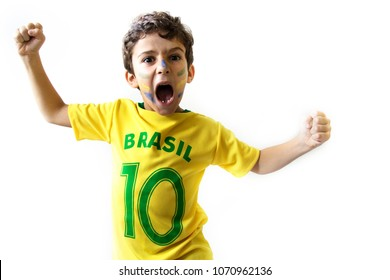 Brazilian boy, soccer player and fan, celebrates on white background. Cheering faces. Hands up
