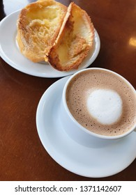 Brazilian breakfast. Bread toast with butter and coffee on a table.