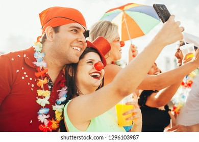 Brazilian Carnival. Couple in costume taking a self portrait