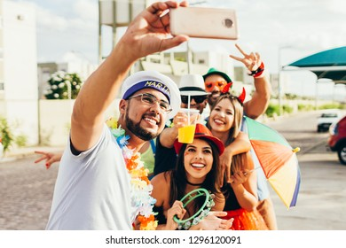 Brazilian Carnival. Group of friends in costumes taking a self portrait