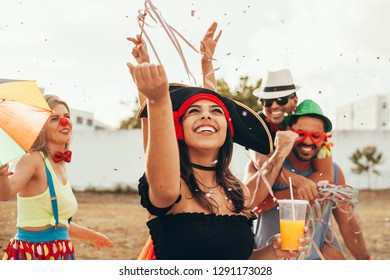 Brazilian Carnival. Group of Brazilian people in costume celebrating the carnival party in the city