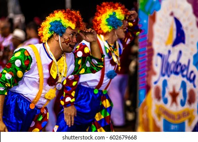 Brazilian Carnival. Parade of the Ita Lions samba school on the avenue in Ilhabela, Brazil, 02/28/2017. Artistic photo with selective focus and background blur