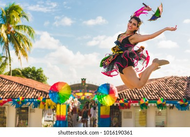 Brazilian Carnival. Women wearing carnival costumes and dancing in Olinda, Pernambuco, Brazil.