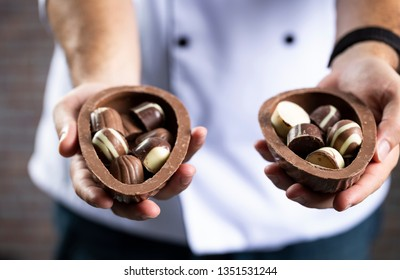 Brazilian Cheff holding a Chocolate Easters eggs