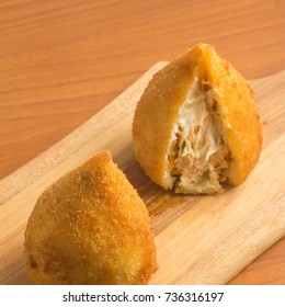 Brazilian Chicken Coxinha over a wooden table