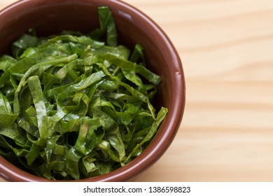Brazilian collard greens (couve) with garlic. Feijoada side dish