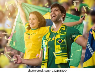 Brazilian couple Celebrating on a stadium on a soccer game, cheering for Brazil to be the champion.