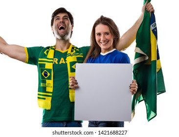Brazilian couple holding white empty boards on a white background.