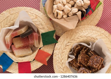 Brazilian Culture. Brazilian Festa Junina typical food. Brazilian sweets Pe de Moleque (peanut brittle), Canjica Popcorn and Jelly mix