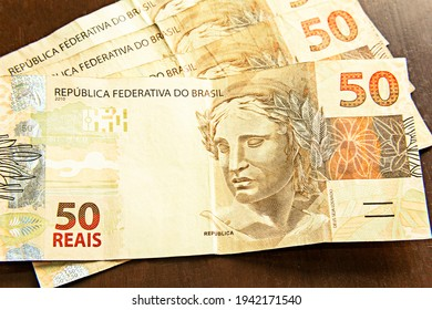 Brazilian currency real money bank notes with coins