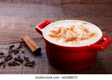 Brazilian dessert canjica of white corn with cinnamon in bowl. Selective focus
