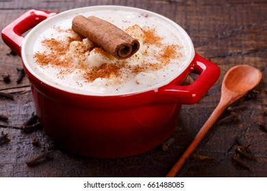Brazilian dessert canjica of white corn with cinnamon in bowl. Selective focus