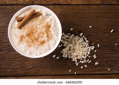 Brazilian dessert sweet canjica / mungunza of white corn with pacoca sweet in bowl and towel. Festa Junina Party Brazilian Culture Concept Image.