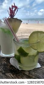 Brazilian drinks - caipirinha and coconut coktail