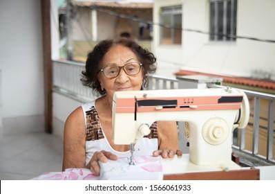 brazilian elderly woman using sewing machine