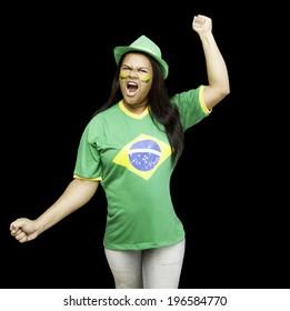 Brazilian fan celebrates on black background