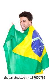 Brazilian fan celebrating with Brazil flag.