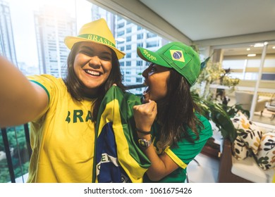 Brazilian fan celebrating during soccer match at home