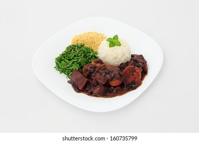 Brazilian Feijoada on a plate for lunch or dinner. Dish on a white background.