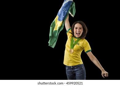Brazilian Female Athlete Winning a golden medal on a black Background.