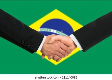 The Brazilian flag and business handshake
