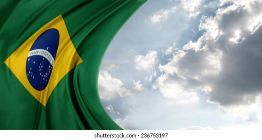 Brazilian flag in front of bright sky