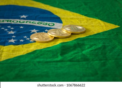 Brazilian  flag and virtual money bitcoin