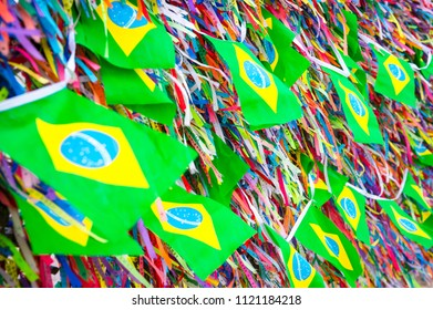 Brazilian flags flying on a wall of wish ribbons at the famous Church Nosso Senhor do Bonfim Salvador in Bahia. Translation: Order and Progress, Our Lord of Bonfim