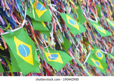 Brazilian flags flying on a wall of wish ribbons at the famous Church Igrega Nosso Senhor do Bonfim Salvador Bahia Brazil
