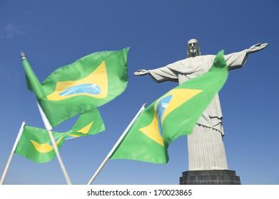 Brazilian flags waving in celebration at Corcovado Christ the Redeemer Rio de Janeiro Brazil