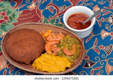 Brazilian food: acaraje on the plate with typical fillings, in table of regional food restaurant