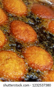 Brazilian food: acaraje, typical dish of Bahia, fried on the board of the street vendor