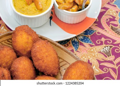 Brazilian food: acaraje with typical fillings, in a table of regional food restaurant