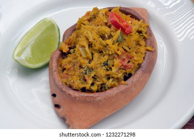 Brazilian food: casquinha de siri, kind of crab stew with typical seasonings, on white dish, with accompanying pepper pots