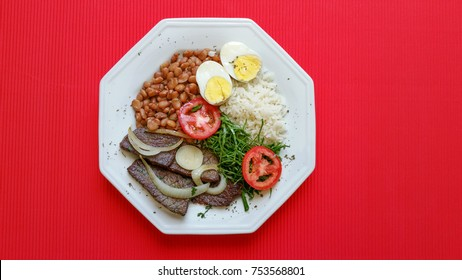 Brazilian food dish on red background
