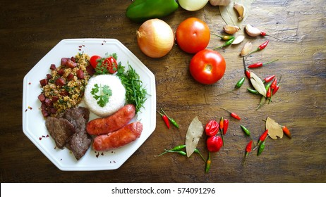 Brazilian food dish seen from the top on aged background