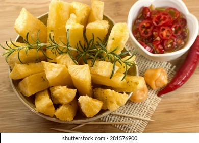 Brazilian food mandioca frita. Deep fried cassava root.