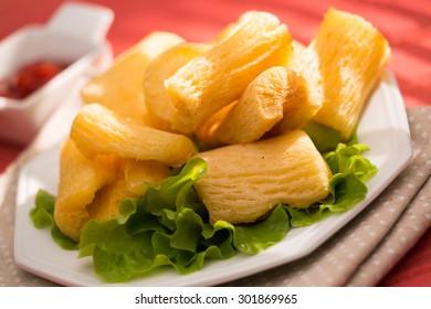 Brazilian food mandioca frita. Deep fried cassava root. - Shutterstock ID 301869965