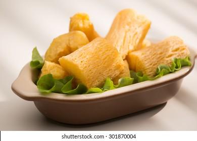 Brazilian food mandioca frita. Deep fried cassava root. - Shutterstock ID 301870004
