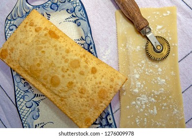 Brazilian food: pastel, pastry in English, typical dish of the street fairs of southeastern Brazil, fried and raw, stuffed with cheese, in crockery decorated in blue with pastry cutter